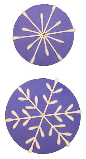 Two snowflakes made with cotton swabs