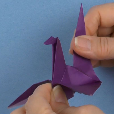 Origami crane with flapping wings